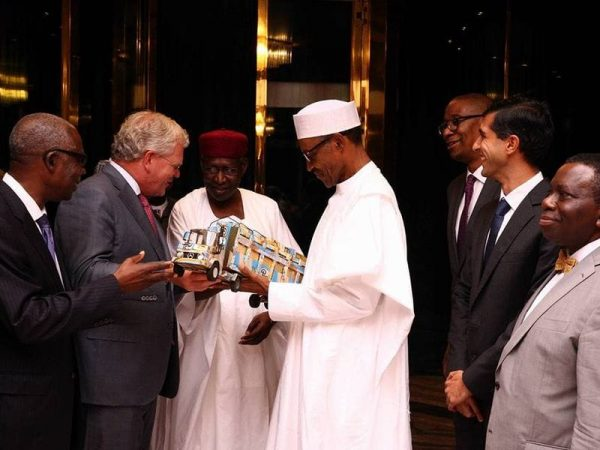 President Buhari with Chief of Staff Abba Kyari, Friesland Campina Global CEO Mr Roelof Joosten and Chairman Friesland Campina Wamco Nigeria, Mr Jacobs Moyo Ajekigbe as he receives a gift from the Global CEO Friesland Campina Netherlands Mr Roelof Joosten at the Statehouse on 9th August 2016