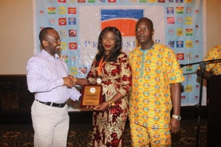 Mrs. Olukayode Flora, from Lagos center receiving her award from Mr Festus Tettey, Head of Marketing (left ) while the Regional Sales Manager Lagos-1, Sunday Olaoshebikan looks on