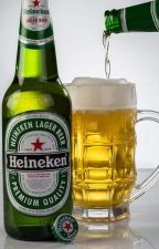 Heineken bottle and glass filled with beer