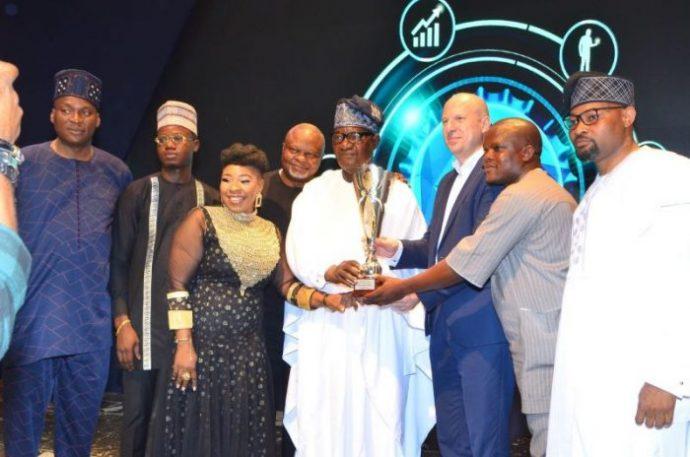 J. Ogungbola_receiveing_award_at_nb_distributors_award_2020