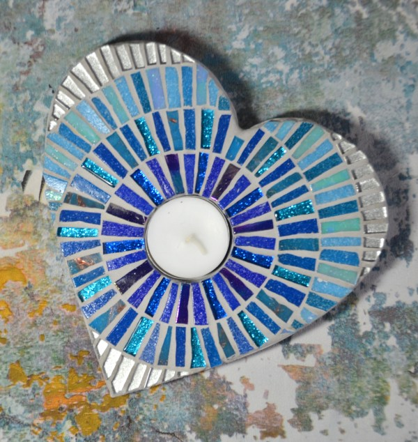 Two heart shaped mosaic blue and silver tea light holders