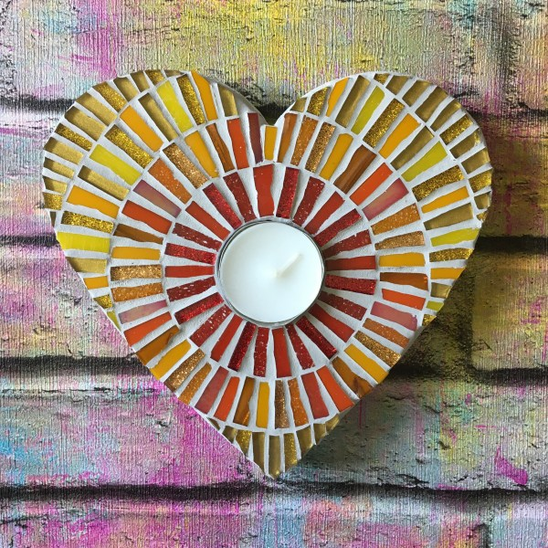 Two heart shaped mosaic red and gold tea light holders