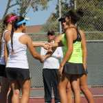 Junior Emily Dekhtyar and junior Jenny Zatikian shake hands with their Peninsula opponents before the game.