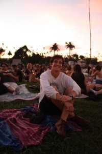 Senior Aaron Karlin sits perched on his blanket as he enjoys the pre-screening atmosphere.
