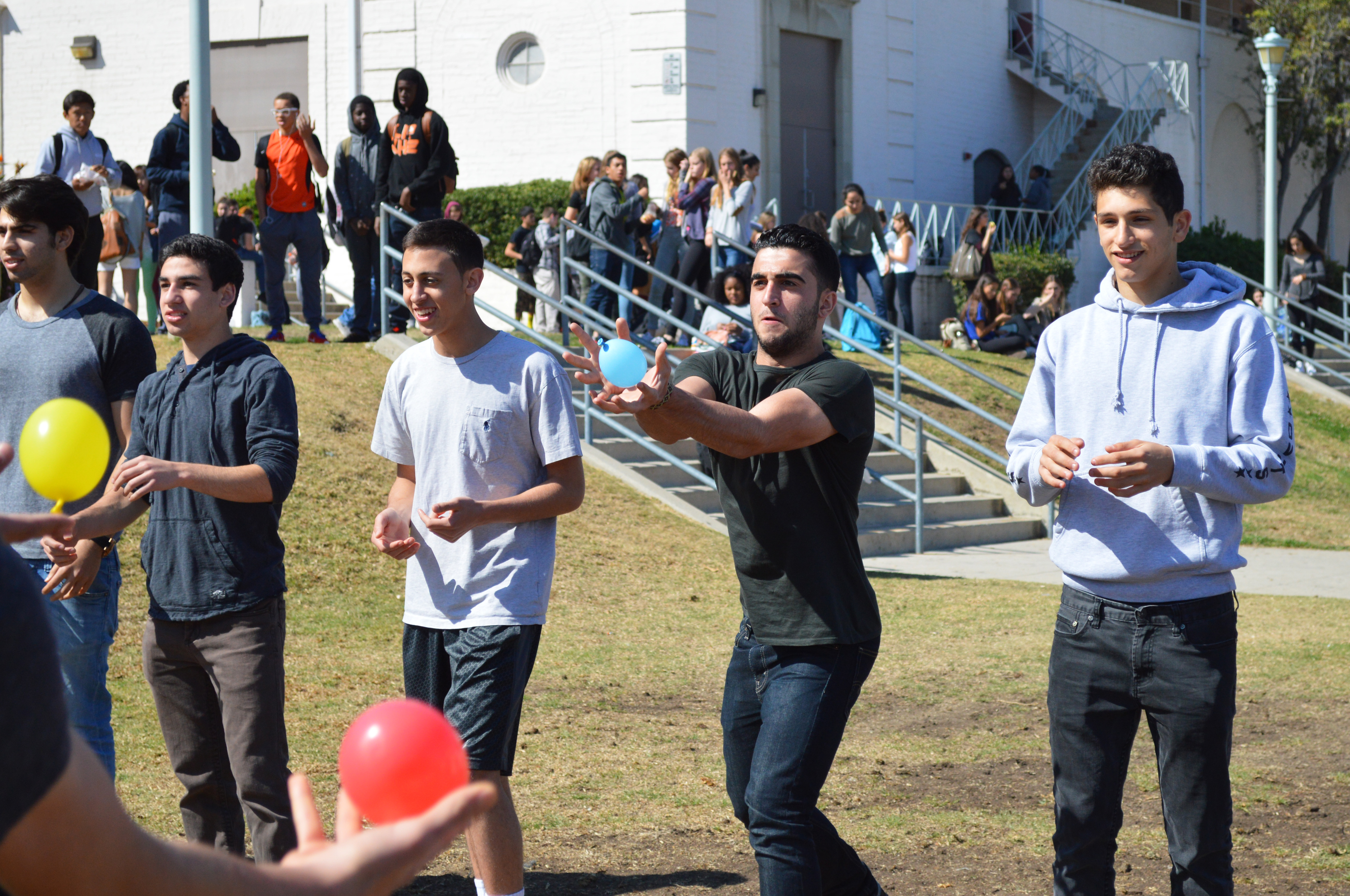 Juniors and seniors participate in the first activity of Monday's lunch event, the water balloon toss.