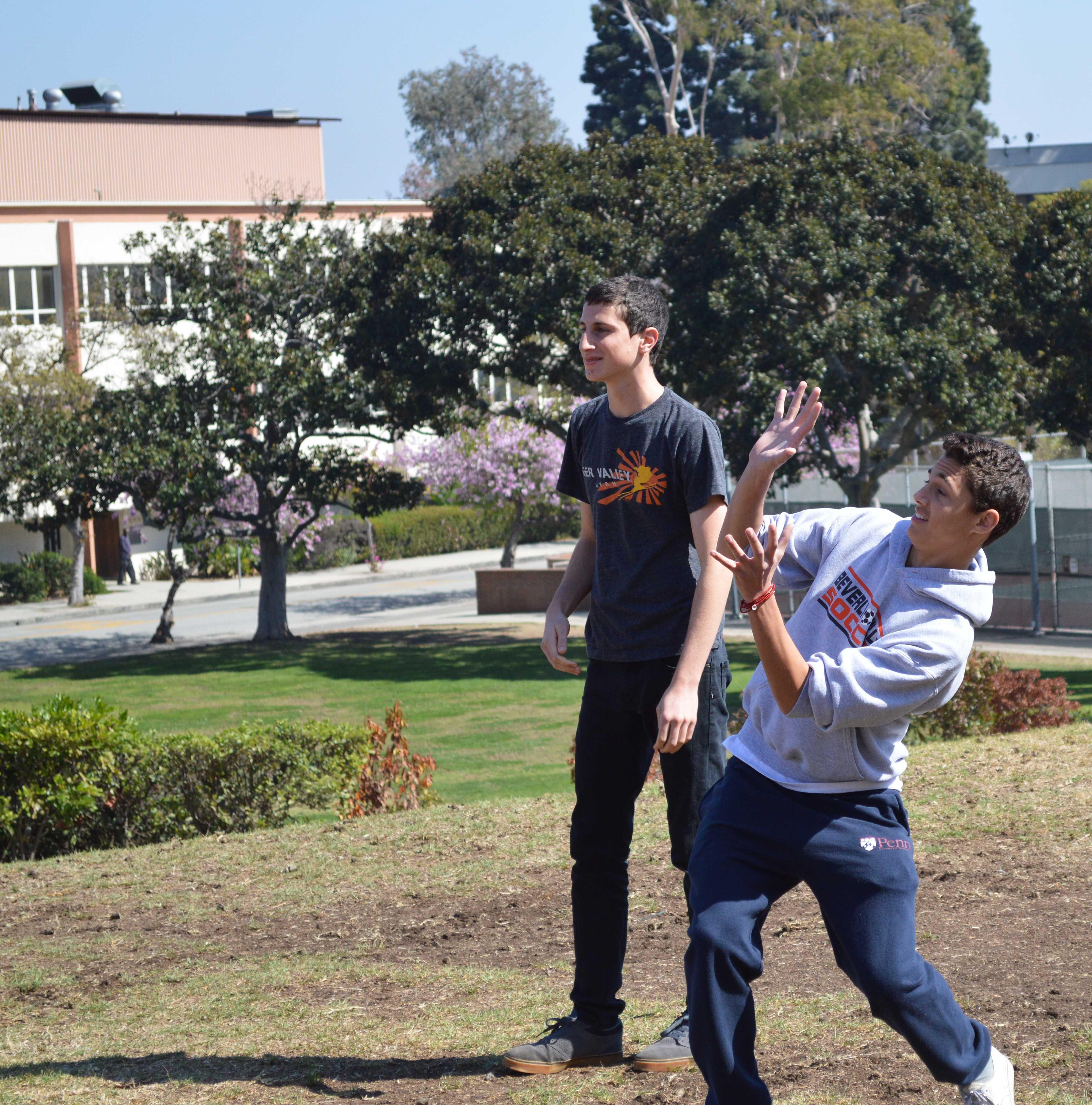 Senior Phinneas Bauer braces himself as he anticipates his partner's water balloon toss.