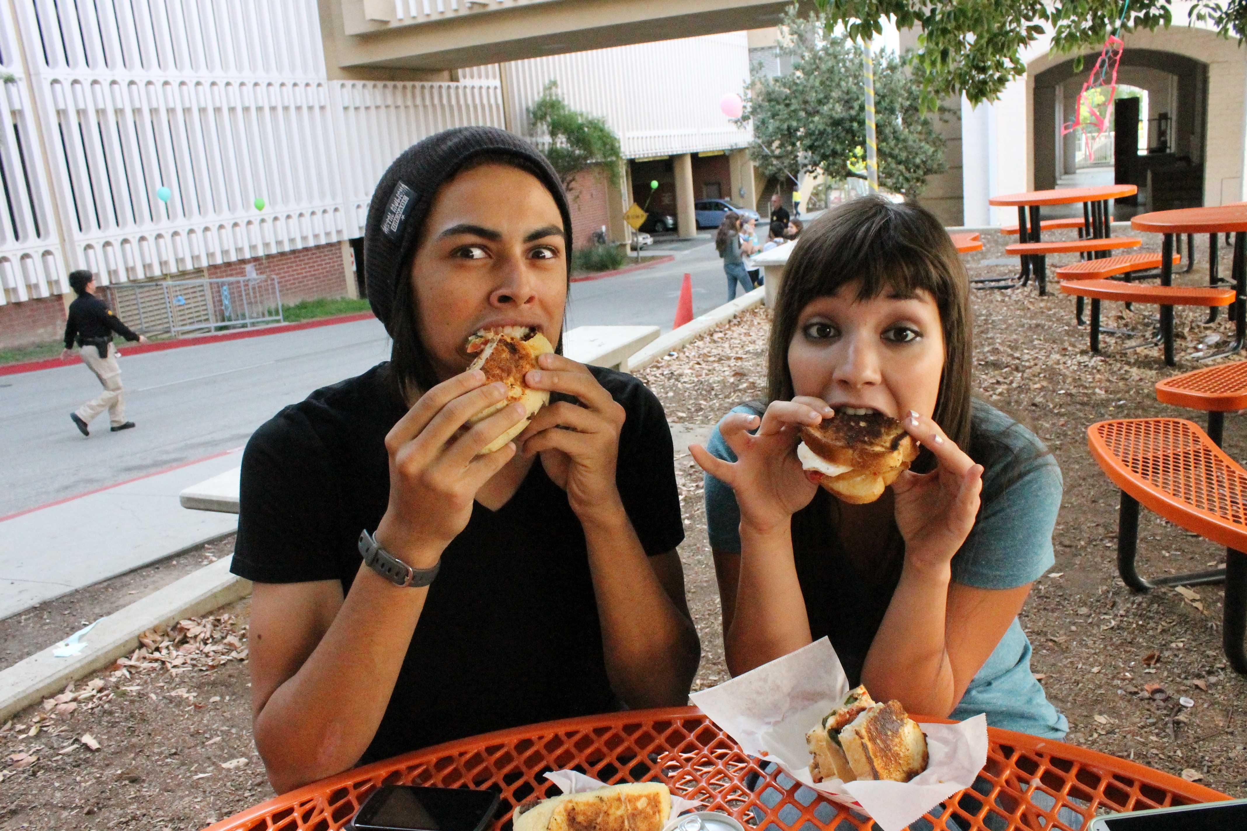 Students enjoy their Holy Aioli sandwiches.