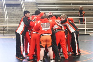 Varsity wrestler Gregory Yaroshevsky leads his team in a pre-grame chant before their tournament.