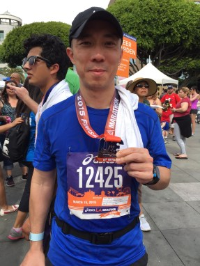 Tse poses with his medal after the race. Photo by: TONIA TSE