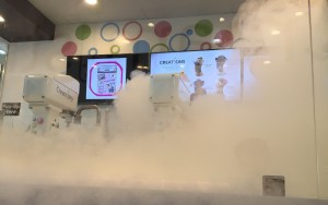 White smoke rises from the Creamistry ice cream machines as a creation is being made.