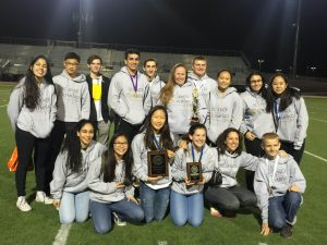 Science Olympiad members celebrate with their awards following the Regional competition. Photo courtesy of: JAMIE KIM.