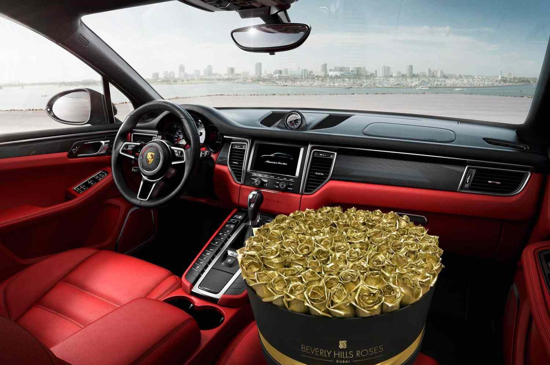 BeverlyHillsRoses golden roses in red porsche