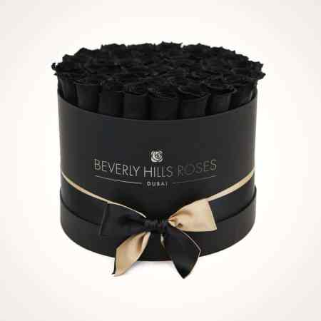 black roses in a box