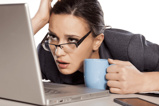 resized Unhappy woman with biz suit coffee and laptop copy