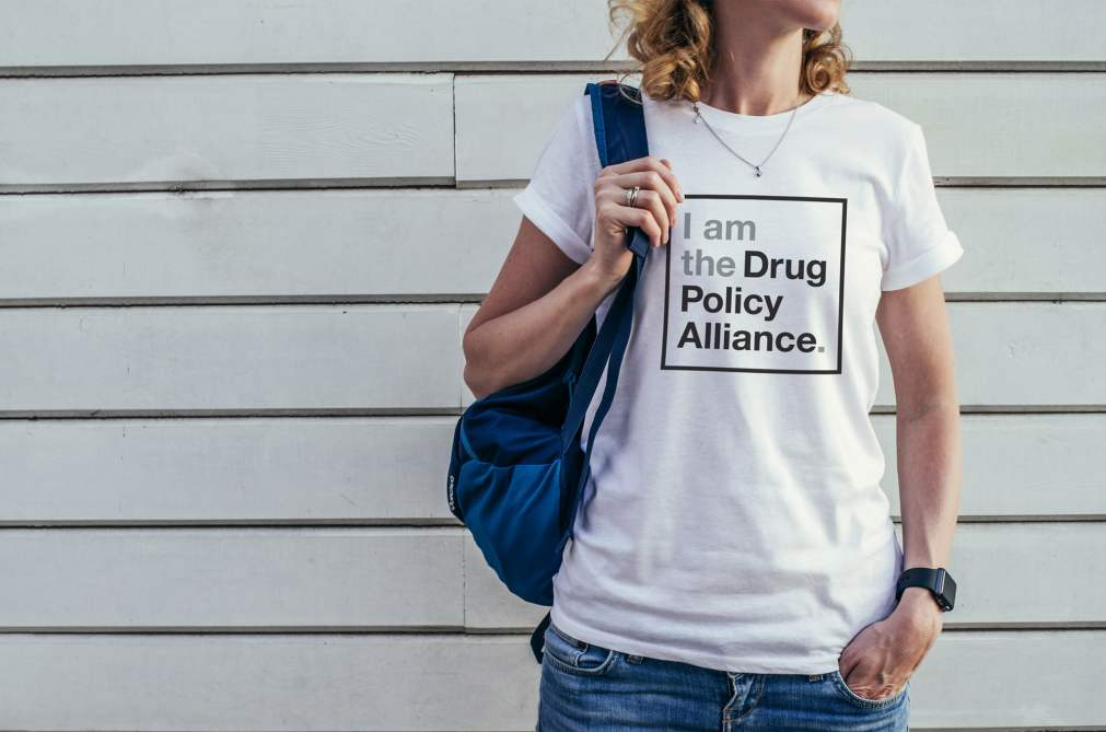 Woman with I am the Drug Policy Alliance shirt
