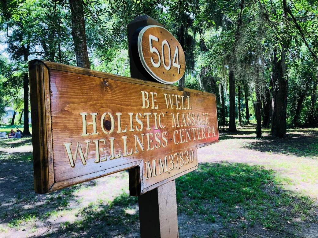 Be Well Holistic Massage Wellness Center Front Parking Lot Sign