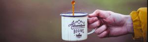 Adventure written cup of coffee