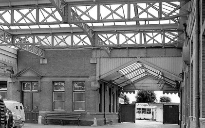 BW-061 - Bexhill West station side entrance between the two buildings seen from the station concourse in 1968. The station refreshment room is seen to the left.
