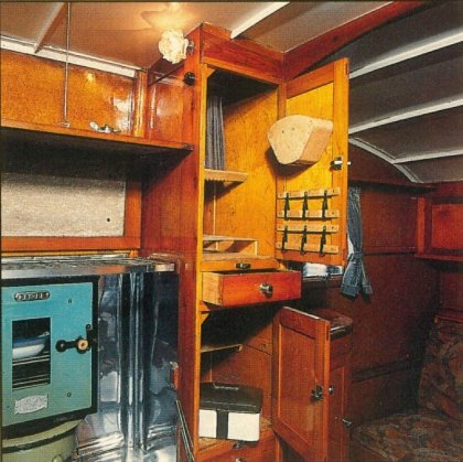 RU-010 – Russell's Dunn motor home interior; Chef's facilities to the left & array of storage units