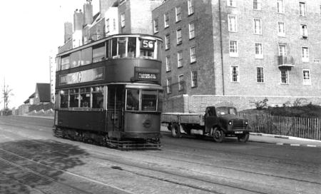 102 route 56 to Peckham Rye on Dog Kennel Hill passing lorry, post-war