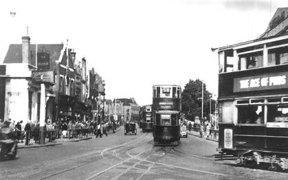 143 route 58 to Victoria with 332 @ Lewisham Clock, 2-9-1951