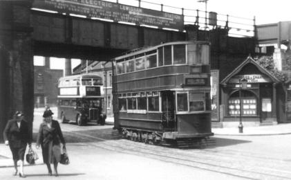 302 passing Lewisham stn followed by RT bus post-war