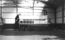 Double-decker open top Guy trolleybus in depot, side view