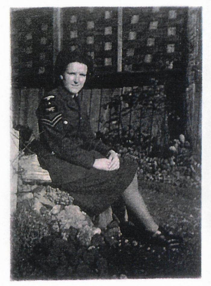 """AAF Corporal Radar Operator Mona Kelly at her digs in Eastbourne wearing her """"no. 1s"""""""