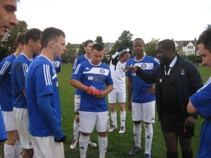 New coach/manager, Anthony Greenidge, with the players