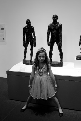 Ava imitating the sculpture behind her