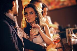 Attractive woman in conversation - main