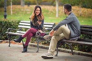 Man and woman flirting in park - main