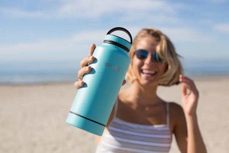 girl holding water bottle