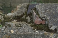 Slate and red brick under the concrete - tell tale signs of Victorian origin