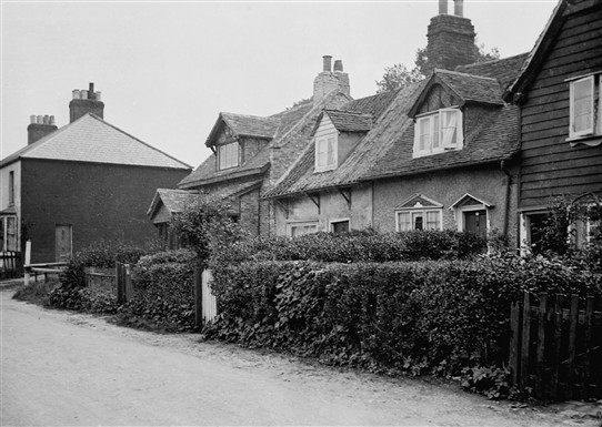 The row of poorhouses in 1938 including the Moorings at the end. Now situated down Essex Way but at this time was East Street.