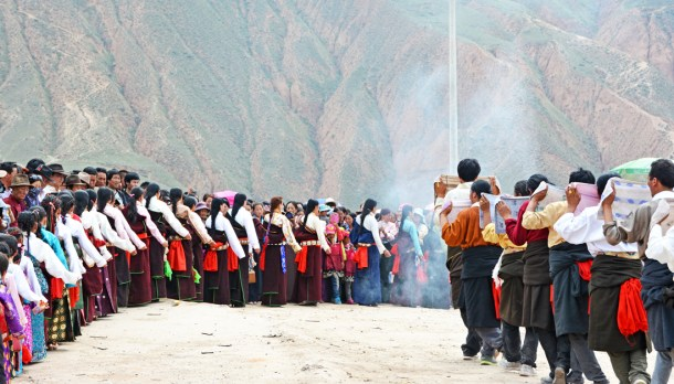 Young Tibetan women and Tibetan men from the host village/group perform toward the end of the day.