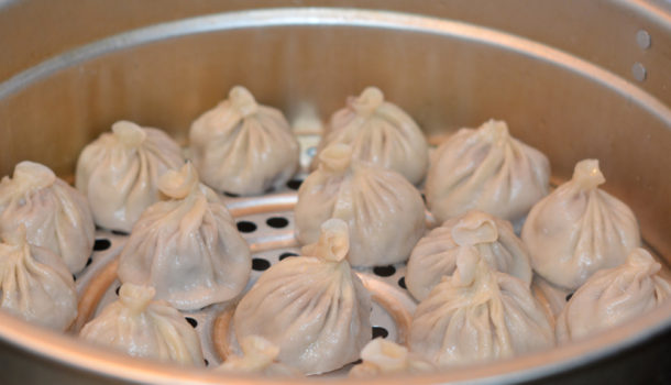 Dumplings ready to pile up trays–cooked in just 12 minutes on a stacked steamer.
