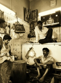 """Butchers take a break from the slaughter""""INA Market, New Delhi"""