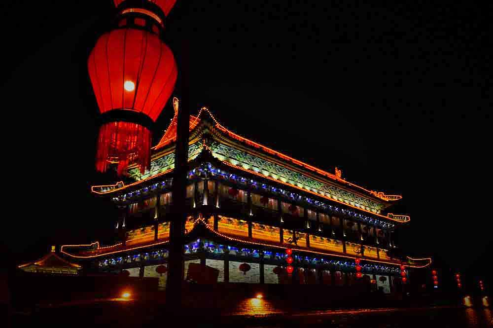 Beautiful Xi'an City Walls at night with lamps and light