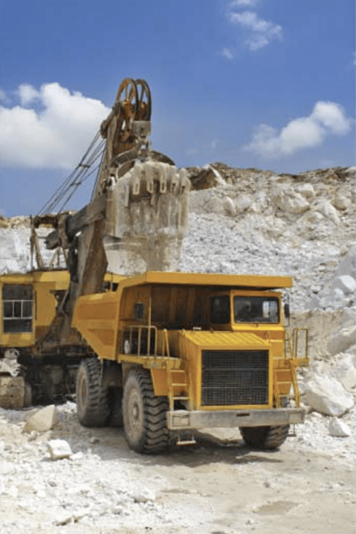 A large ore haul truck being loaded by a shovel. (Foreign Trade, 2018, No. 107-01)