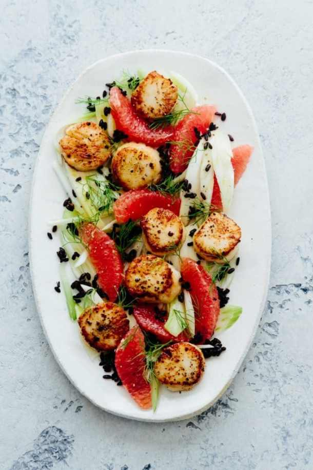 a platter of seared scallops, grapefruit, fennel, and wild rice salad