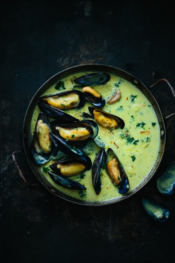 a pot of mouclade mussels in cream and curry sauce