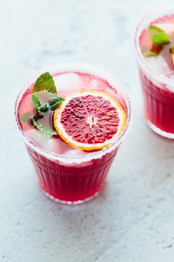 two glasses of blood orange margaritas