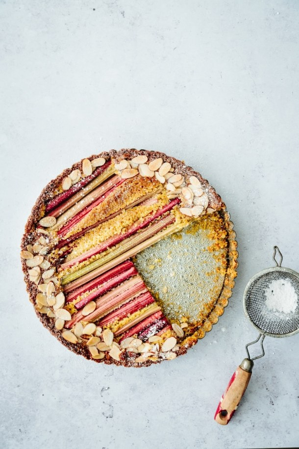 cut rhubarb polenta cake with sifter