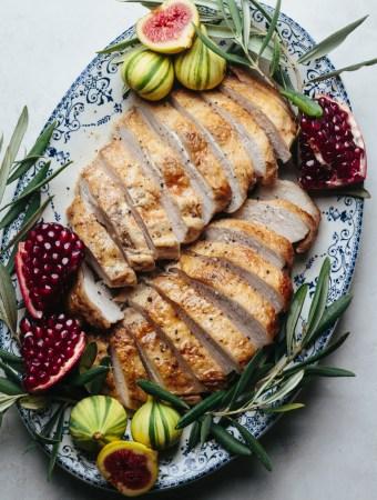 a platter of sliced turkey breast