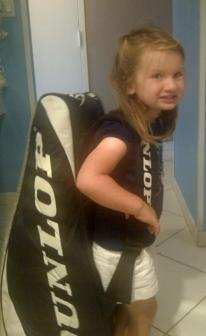 girl with tennis bag