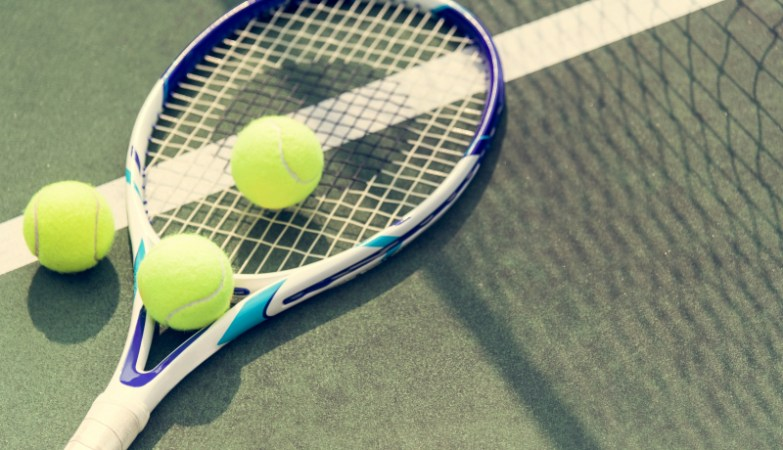 tennis balls on a tennis racquet