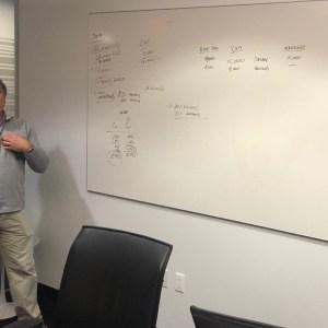 Consultant at white board