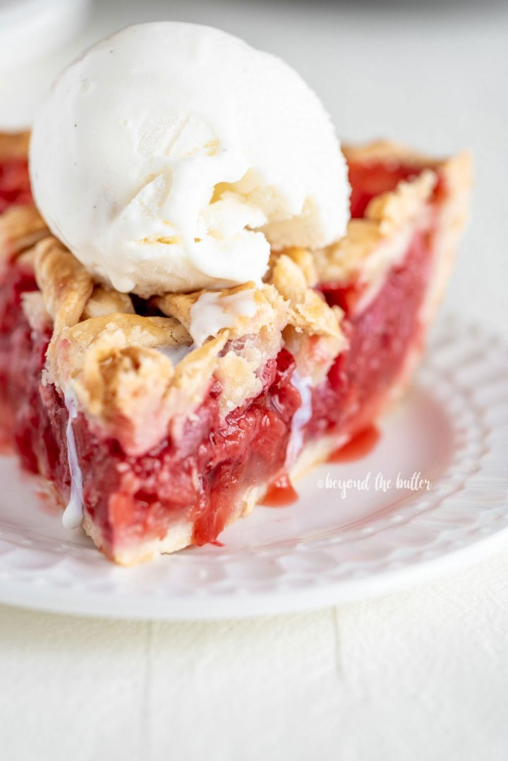 Strawberry Rhubarb Pie with Homemade Buttery, Flaky Pie Crust and ice cream | All Images © Beyond the Butter, LLC