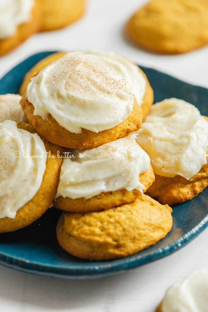 Plate of pumpkin cinnamon cookies with vanilla cream cheese frosting | All Images © Beyond the Butter™
